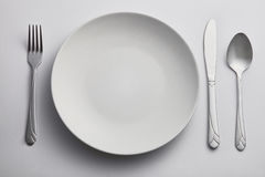 Empty kitchen plate Stock Images