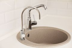 Empty kitchen sink with faucets. Idea for interior design royalty free stock image