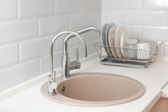 Empty kitchen sink with faucets. Idea. For interior design stock images