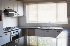 Empty kitchen with white cabinets Stock Photo
