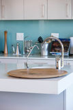 Empty kitchen with white cabinets Royalty Free Stock Images