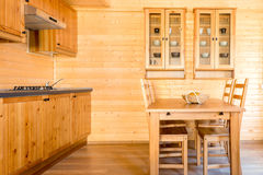Empty kitchen in a wooden house Stock Photo