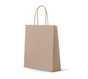 Empty kraft Brown Shopping Bag for advertising and branding. MockUp Package. Vector Illustration. Royalty Free Stock Images