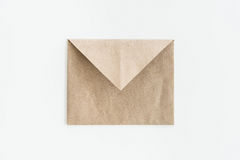 Empty kraft envelope isolated on white Royalty Free Stock Photo