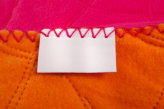 Empty label. Macro of white blanket label Royalty Free Stock Photo