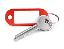 Empty label keyring. Door key and red plastic keyring with blank tag for text or number isolated on white background Royalty Free Stock Photo