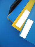 Empty Labels on Folders. Blue and yellow folders sitting on an office tray. Add your own words on the empty white labels stock photo