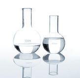 Empty laboratory flasks with a clear liquid Stock Photo