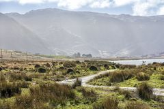 Empty Road Ireland 0005. Empty lakeside road in County Kerry on the west coast of Ireland Stock Image