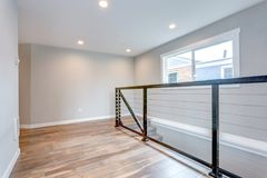 Empty landing with horizontal railings and hardwood floor. Empty landing with horizontal railings and hardwood floor stock photos