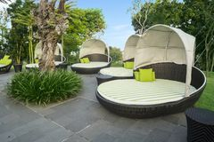 Empty large loungers in luxury hotel royalty free stock photos