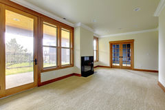 Empty large room with fireplace. New luxury home interior. Stock Photography