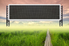 Empty large sign with wood bridge between rice field Stock Photo