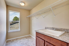 Empty laundry room interior with tile flooring Royalty Free Stock Photography
