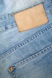 Empty leather label on a blue jeans Stock Image