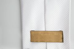 Empty leather label on a white tie Royalty Free Stock Photography