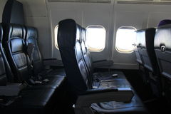 Empty leather seats, offering comfort to travelers on upcoming flight Royalty Free Stock Photo
