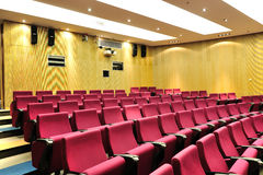 Empty lecture theater. With red sit stock photos