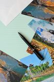 Empty letter pad with scenic postcards Royalty Free Stock Images