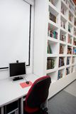 Empty library, computers, books Royalty Free Stock Photography