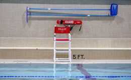 Free Empty Lifeguard Chair By An Indoor Pool Stock Images - 173259964