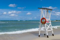 Empty lifeguard chair/tower on tropical beach stock photo