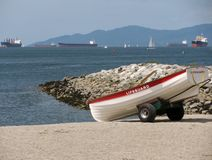 Empty lifeguard rowboat on beach Royalty Free Stock Photos