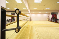 Empty light ballet class. With ballet lathe and thick carpet on floor stock images
