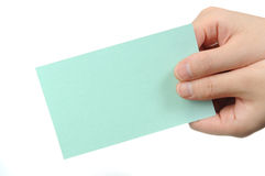 Empty light green business card in a woman's hand Royalty Free Stock Image