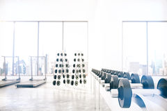 Empty light gym room with Gym interior with dumbbells. And treadmills Stock Images