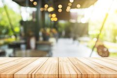 Empty light wood table top with blurred in coffee shop backgroun. D. can be used product display stock image