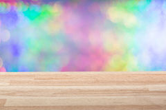 Empty light wood table top with colorful background. Can be used for new year, christmas or any holiday event project. royalty free stock photo