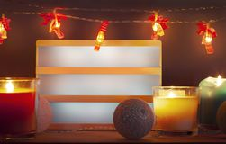 Empty lighbox and Christmas decorations with candles royalty free stock photo