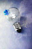 Empty lightbulb on dark sky: stop pollutants. Transparent lightbulb on dark sky representing the end of pollutants Royalty Free Stock Photo