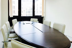 Empty lighting meeting room with long table Stock Photos