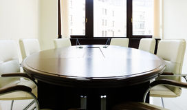 Empty lighting meeting room with long table Royalty Free Stock Photos
