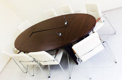 Empty lighting meeting room with long table Royalty Free Stock Image