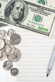 Empty lined paper, money and pen Royalty Free Stock Image