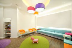 Empty lit room with soft couches. Chairs and toys for children vector illustration
