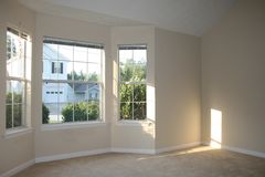 Empty Living Room. With sun shining through window Royalty Free Stock Photos