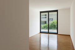 Empty living room with balcony Royalty Free Stock Images