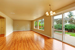 Empty living room with exit to backayrd deck Royalty Free Stock Image