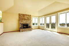 Empty living room with a fireplace Stock Image
