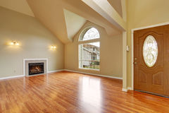 Empty living room with fireplace nd big arch window stock image