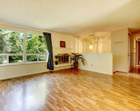 Empty living room with fireplace and shiny hardwood floor stock images