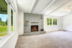 Empty living room with fireplace Stock Photography