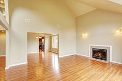 Empty living room with high ceiling and fireplace Stock Image