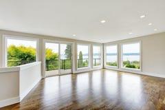 Empty living room interior in light tones with hardwood floor Royalty Free Stock Image
