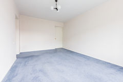 Empty Living Room. Interior photo of the empty living room with white walls and gray carpet Stock Photo