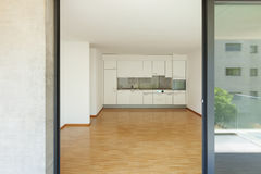 Empty living room with kitchen Stock Photo